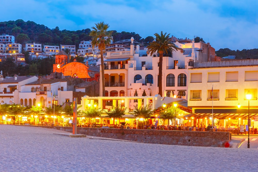 Night beach and promenade with cafes and restaurants in Tossa de Mar on the Costa Brava, Catalunya, Spain